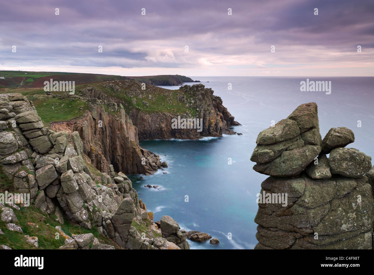 Looking across Zawn Trevilley from the clifftops at Pordenack Point towards Carn Boel, Land's End, Cornwall, - Stock Image