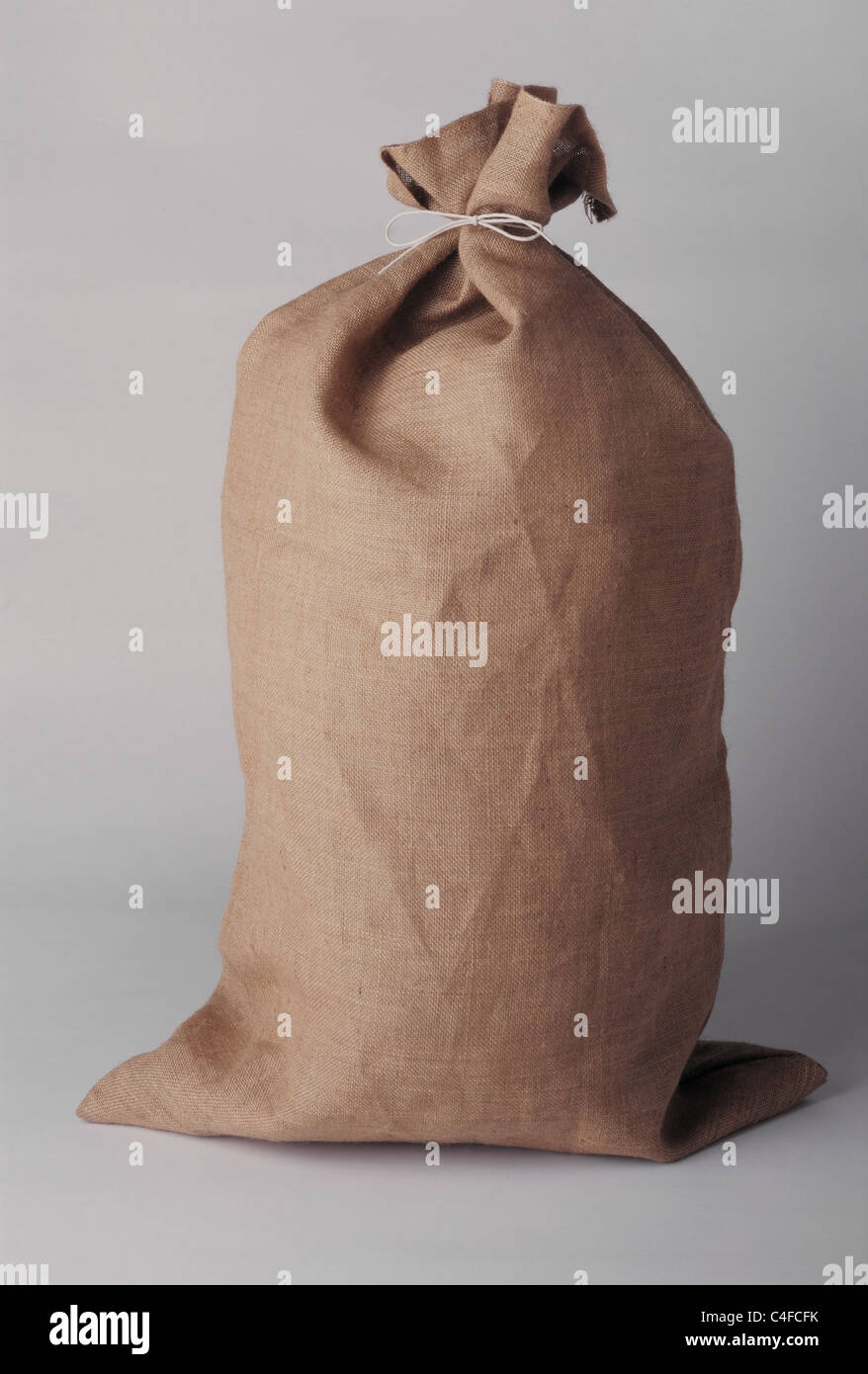 Hessian sack tied with string. - Stock Image