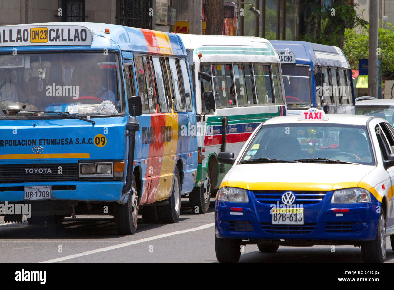 Public transportation buses and taxicab in Lima, Peru. - Stock Image