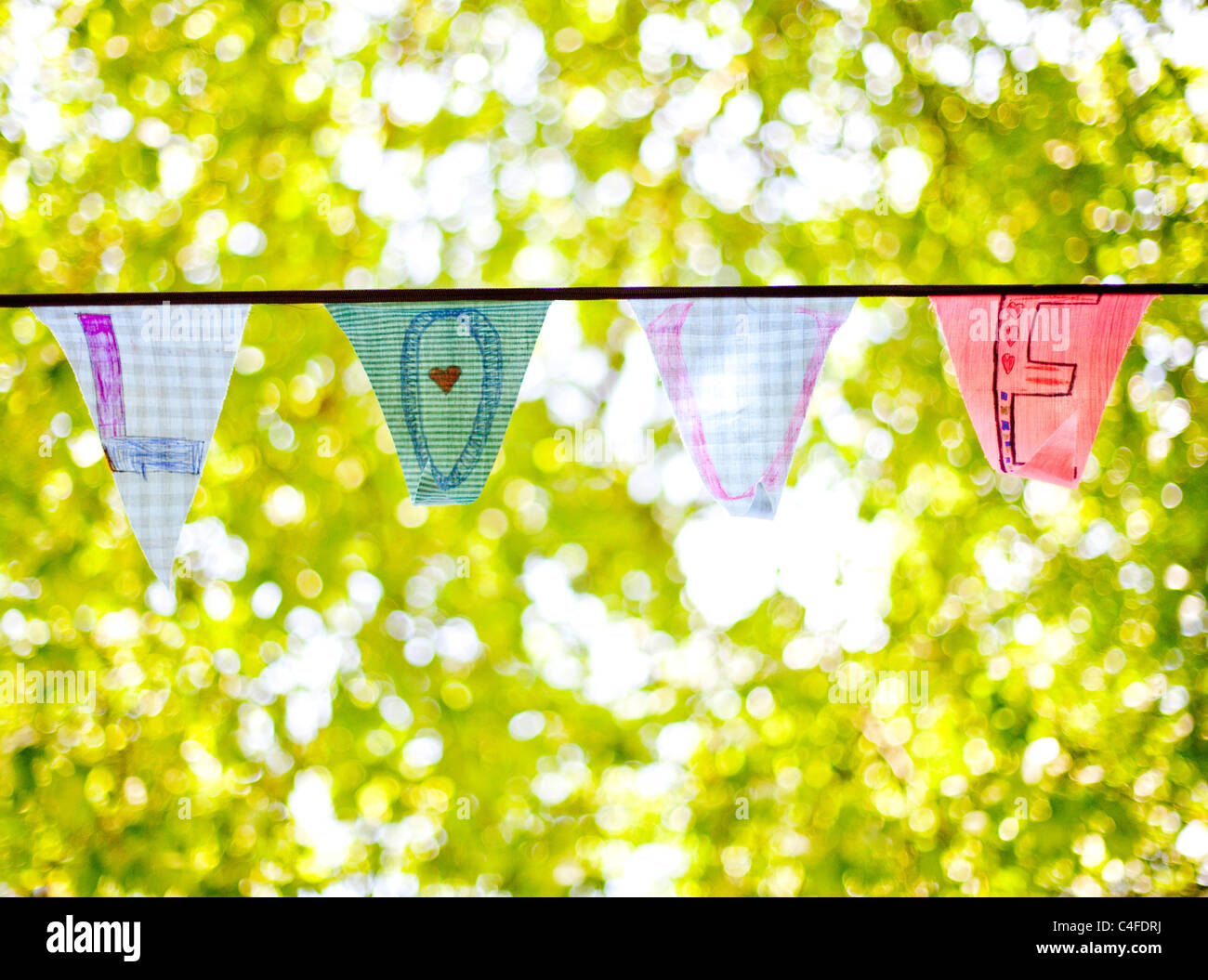 "A line of bunting flags spelling ""Love"" Stock Photo"