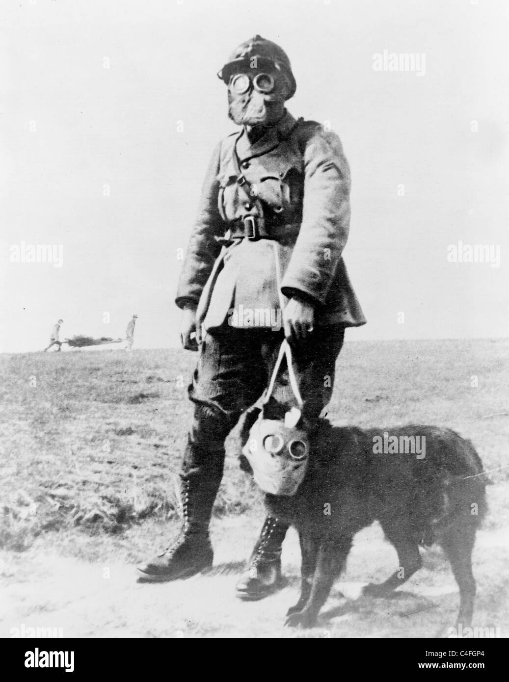 A French sergeant and a dog, both wearing gas masks, on their way to the front line. World War 1 - Stock Image