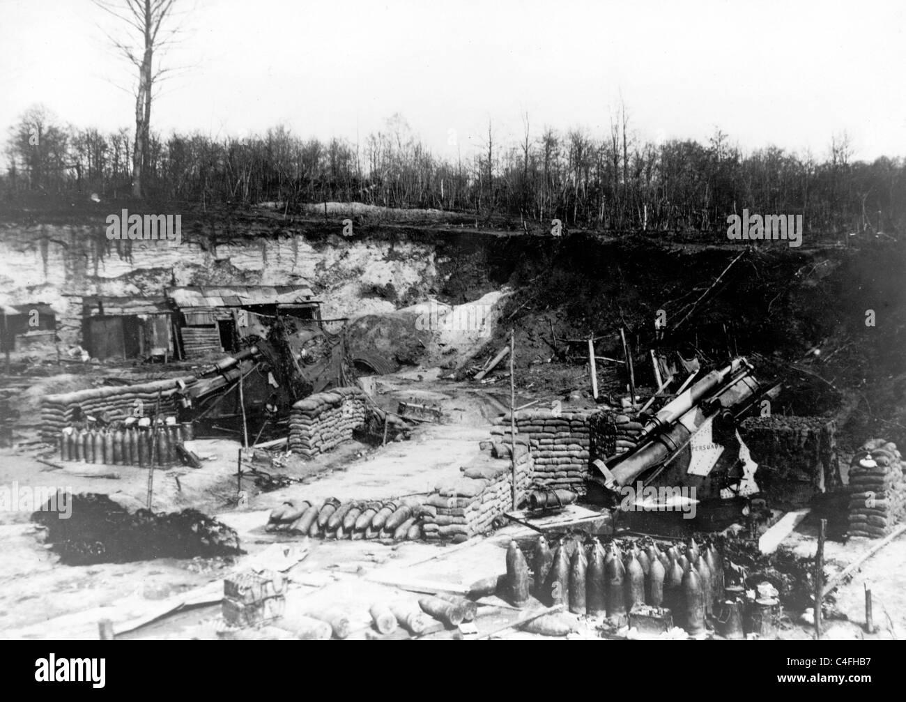 Artillery position showing guns, ammunition shells and sandbags - Stock Image