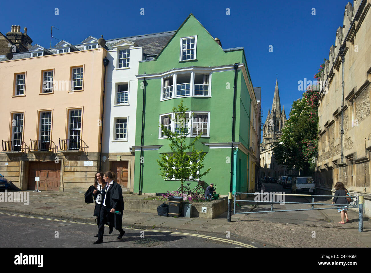 Students outside Oriel College, Oriel Street, with University Church Of St Mary The Virgin behind, Oxford University, - Stock Image