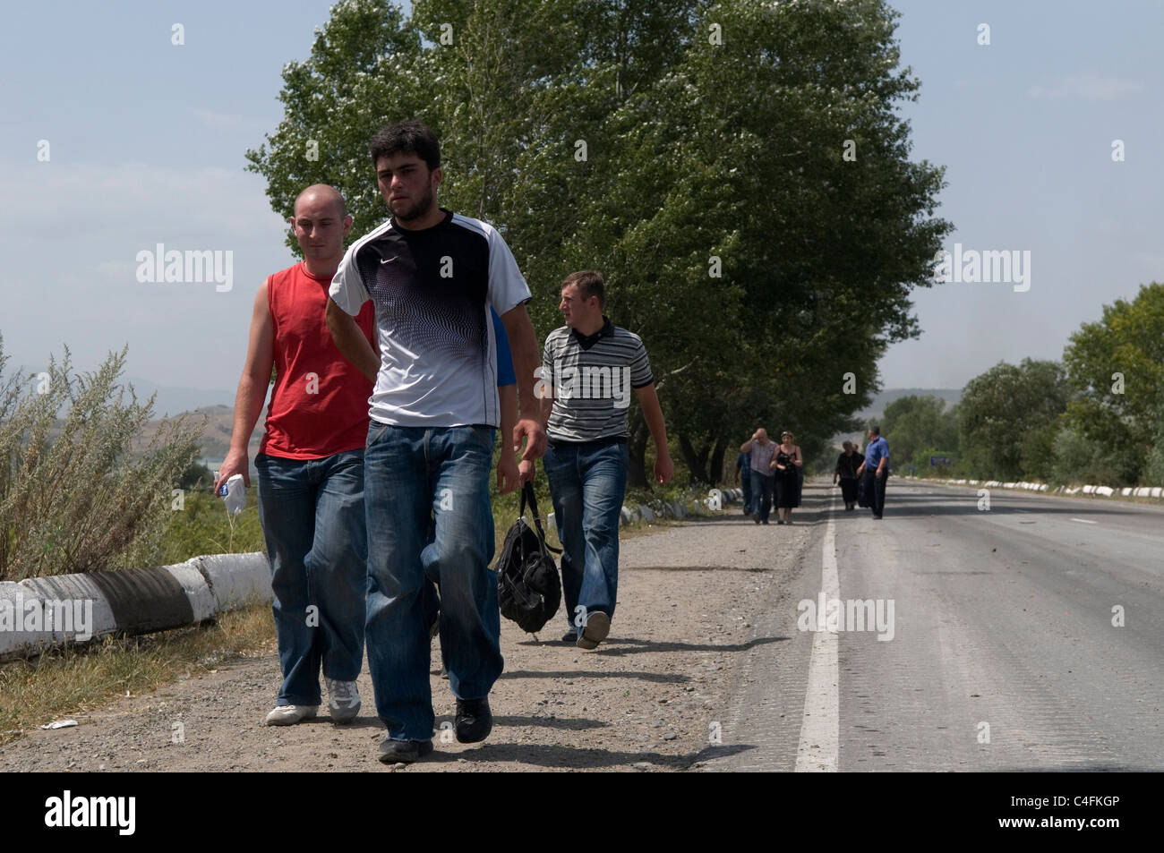 Georgian civilians fleeing the city of Gori soon after Russian forces entered the city during the Russo-Georgian - Stock Image