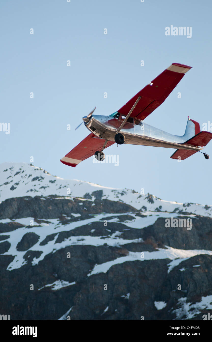 Cessna 185 Bush plane flying and competing in the STOL competition