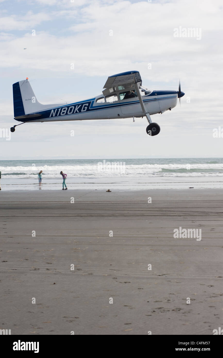 Cessna 185 taking off from the beach on Hinchenbrook Island