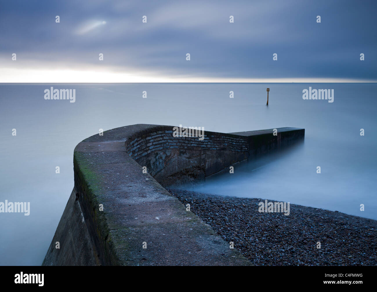 Stone jetty on the seafront at Sidmouth, Devon, England. Winter (February) 2011. - Stock Image