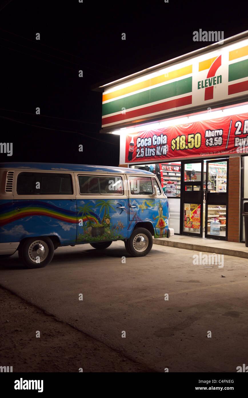 Painted VW van in front of 7 Eleven - Stock Image
