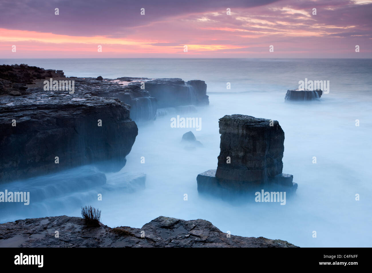 Beautiful sunrise over the rocky coast of Portland Bill on the Jurassic Coast, Dorset, England. Winter (February) Stock Photo