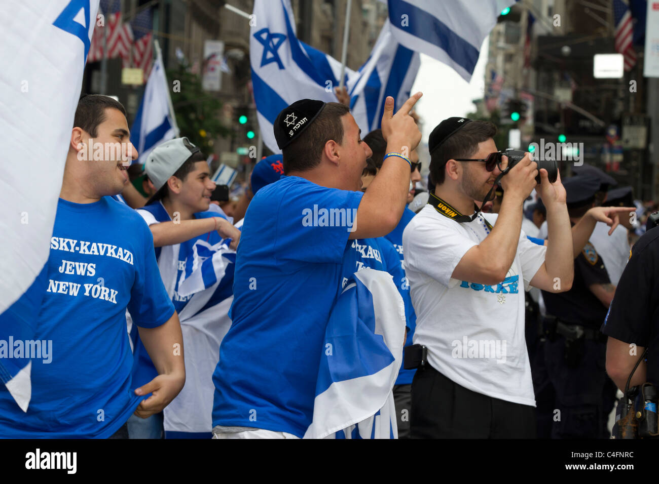 Pro Israel marchers heckle anti-Israel protesters at the 2011 Celebrate Israel Parade on Fifth Avenue in New York - Stock Image