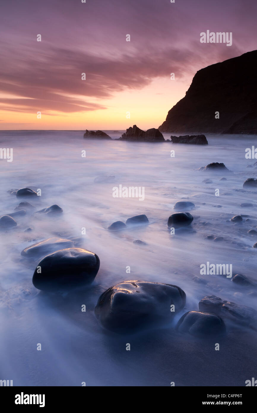 Twilight on the beach at Duckpool on the North Cornish Coastline, Cornwall, England. Spring (March) 2011. - Stock Image