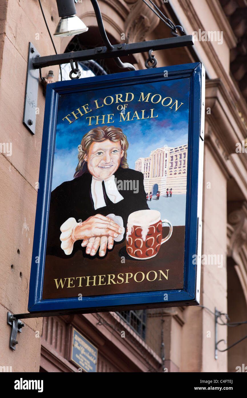 Pub sign showing portrait of Tim Martin, founder and chairman of JD Wetherspoon pub chain, London, UK - Stock Image