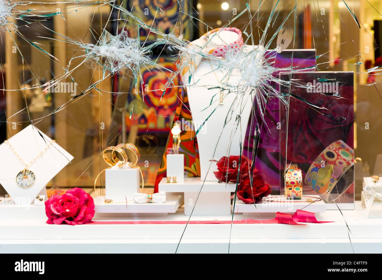 Vandalised shop window, London, UK - Stock Image