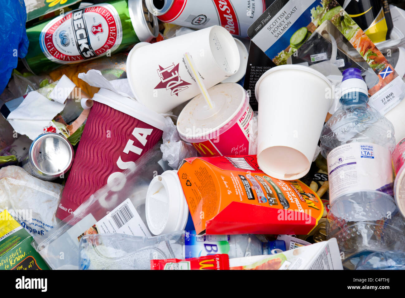 Pile of used disposable plastic fast food and soft drinks containers, UK - Stock Image