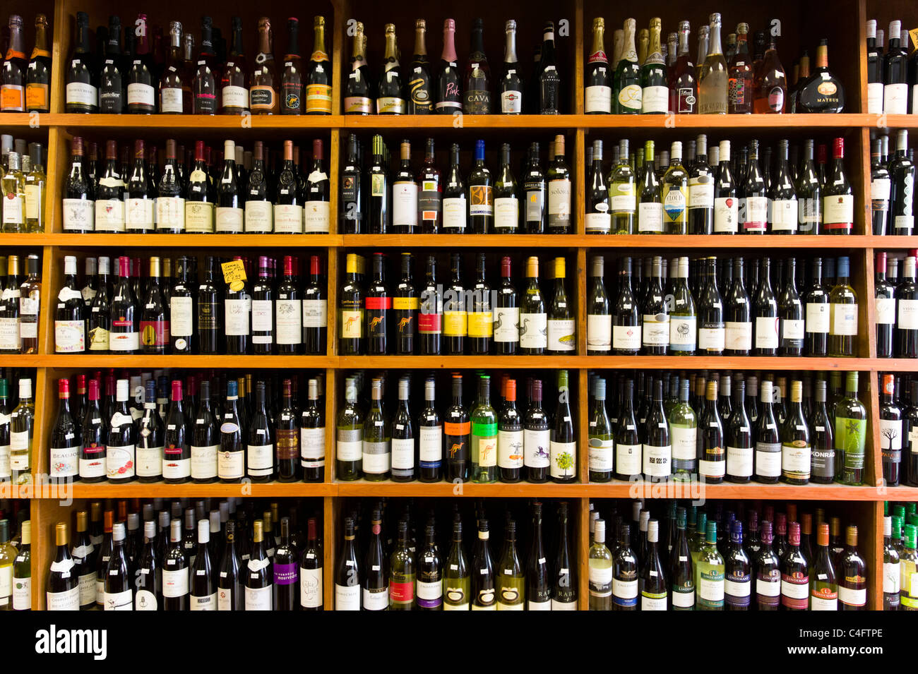 Rows of wine bottles in local independent off licence, London, UK - Stock Image