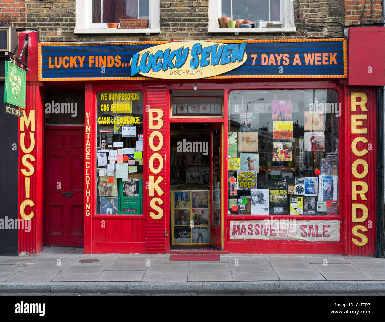 Secondhand books and records at small independent shop on Stoke Newington Church Street, Hackney, London, UK - Stock Image