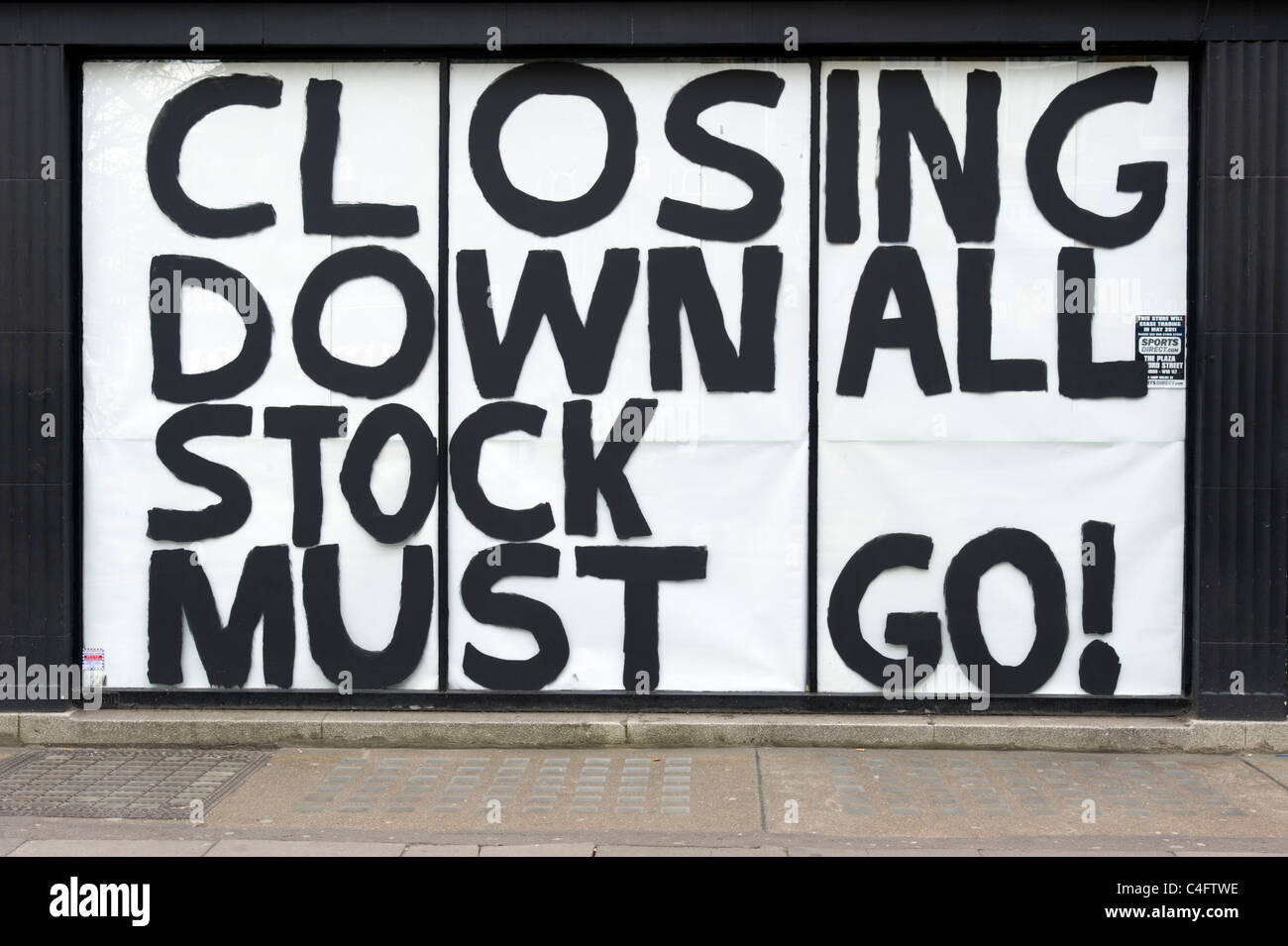 Closing down sale all stock must go sign on shop which has gone out of business, London, UK - Stock Image