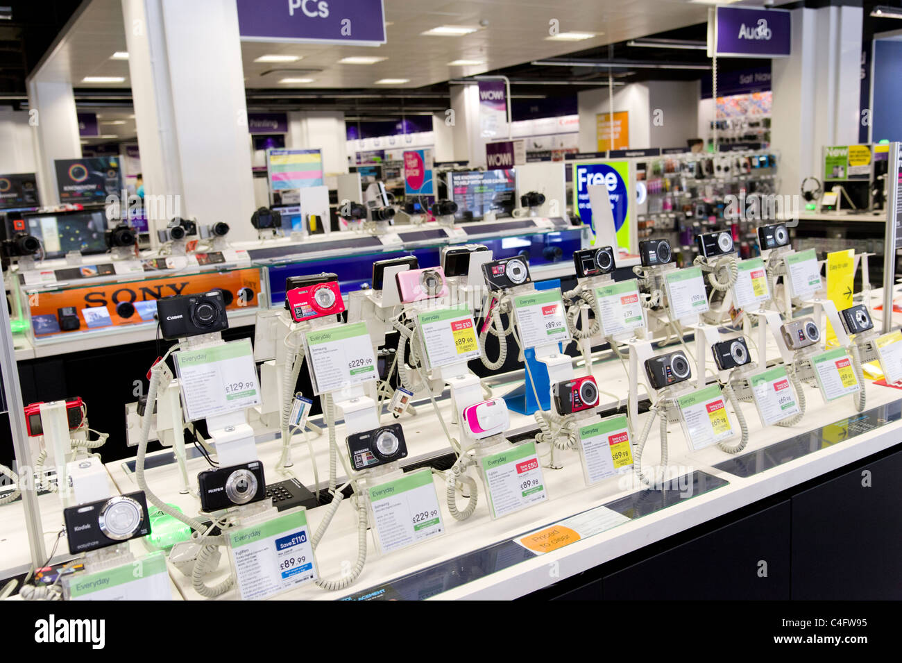 Compact digital cameras in PC World, London, UK - Stock Image