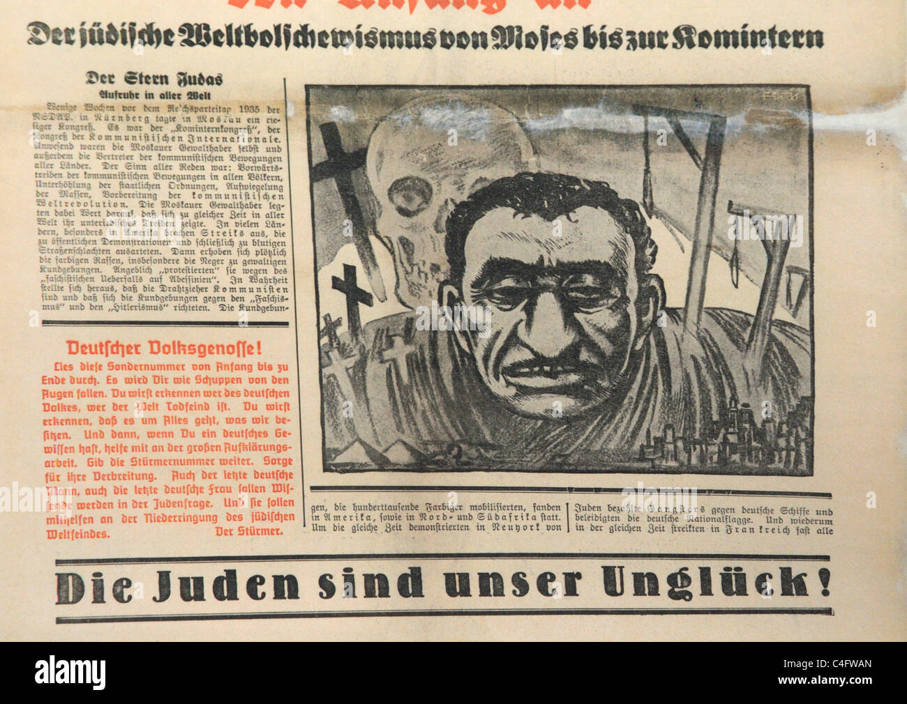A caricature of a Jew and the headline 'the jews are our bad luck' in the nazi newspaper Die Sturmer - Stock Image