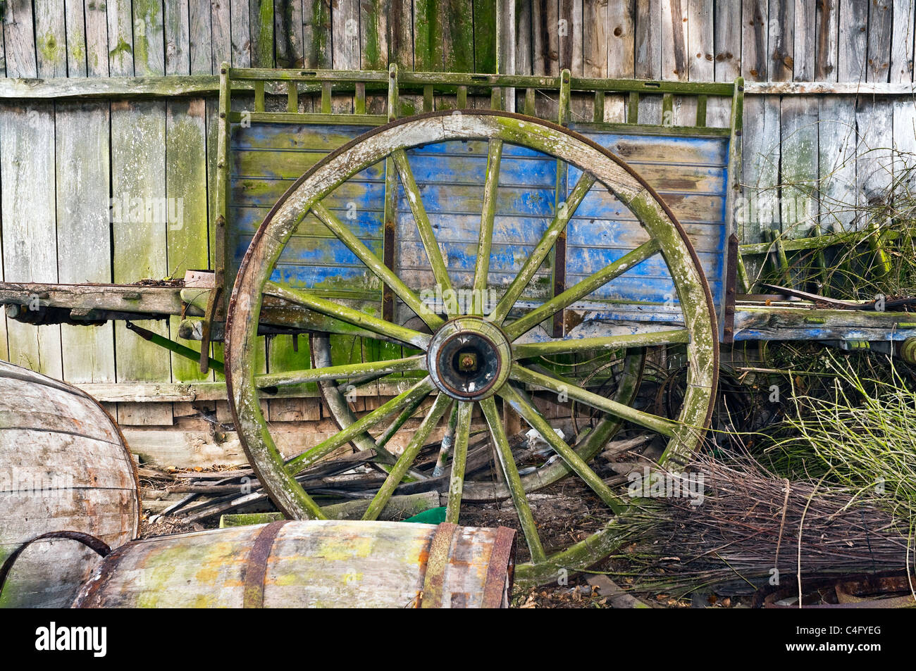Old disused farm-cart in barn - Indre-et-Loire, France. - Stock Image