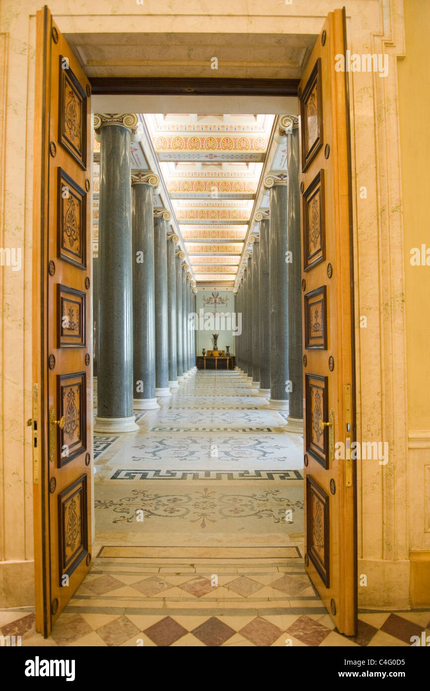 Russia St Petersburg Hermitage Museum Winter Palace hall dominated by massive pillars or columns - Stock Image