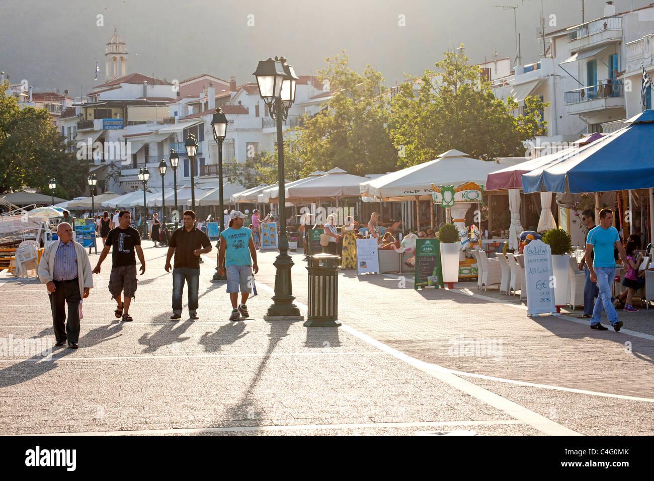 restaurants at the promenade of the old harbour of Skiathos Town, Skiathos Island, Northern Sporades, Greece  - Stock Image