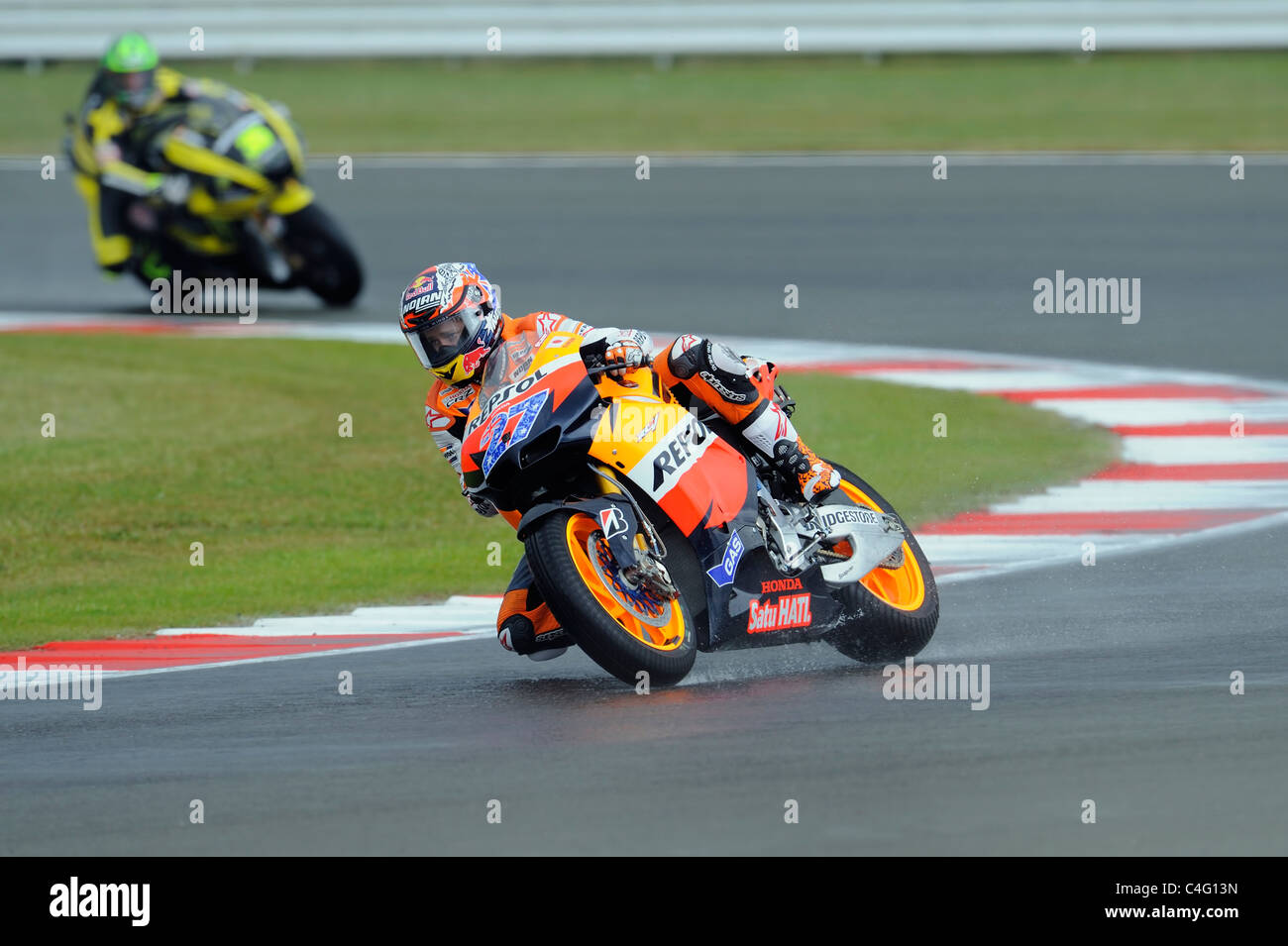 casey stoner and cal crutchlow in wet conditions, moto gp, 2011, - Stock Image