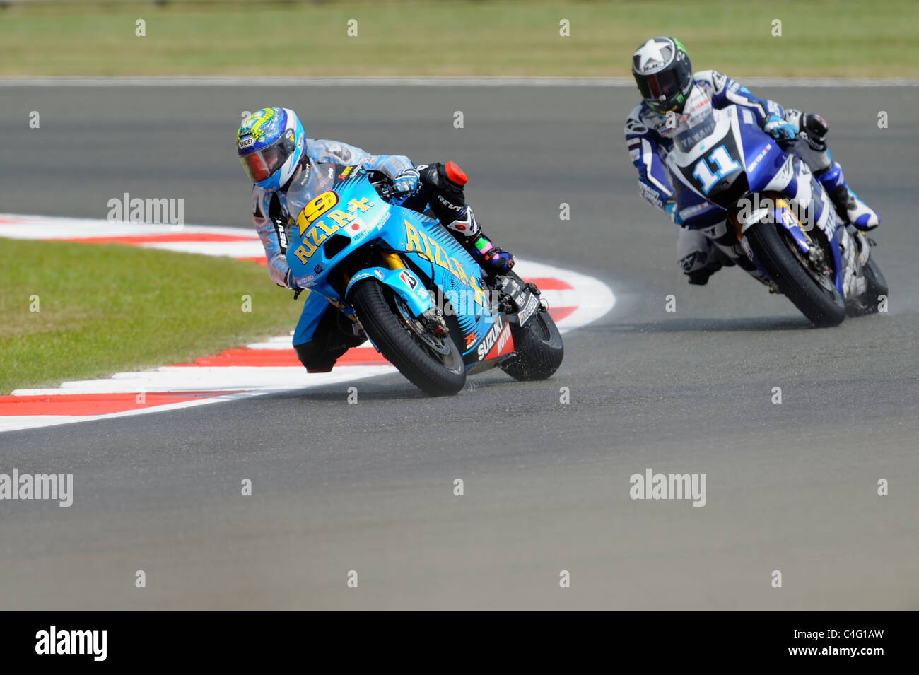 alvaro-bautista-and-ben-spies-in-wet-conditions-moto-gp-2011-C4G1AW.jpg
