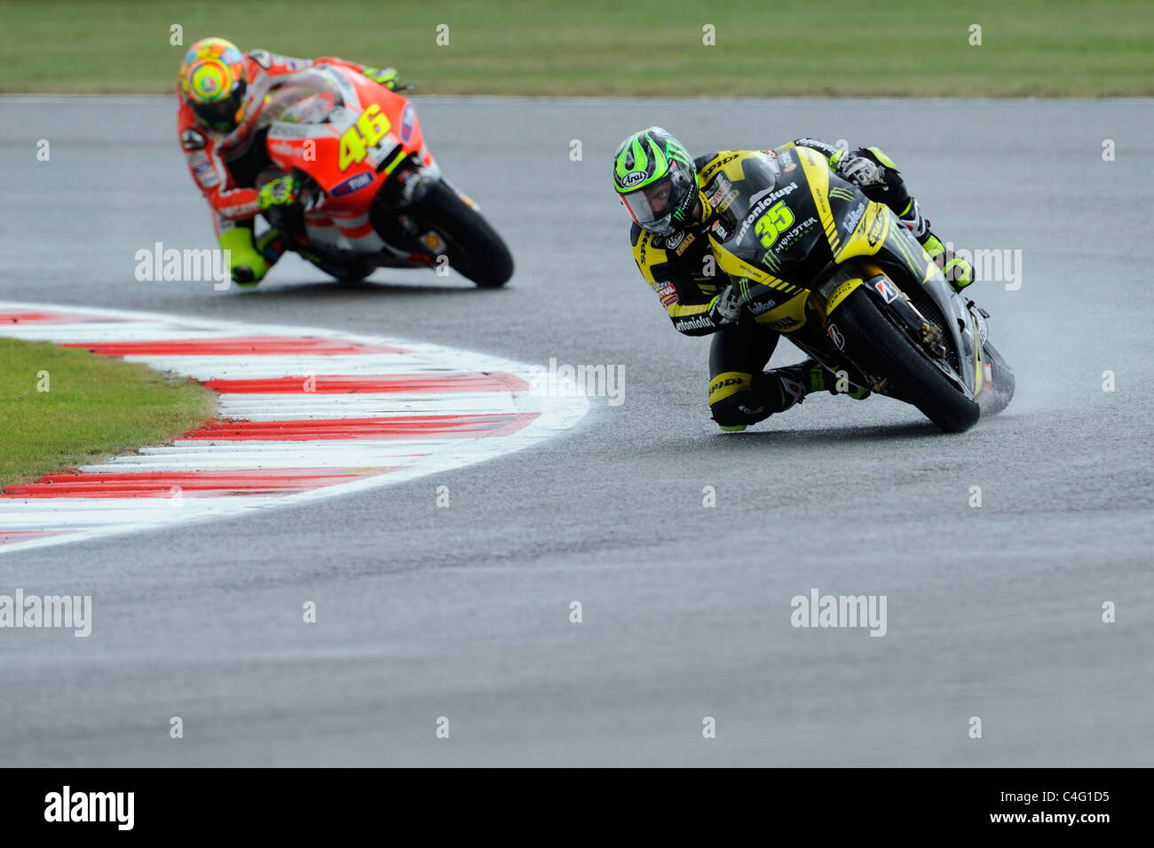 cal crutchlow and valentino rossi in wet conditions, moto gp, 2011, - Stock Image