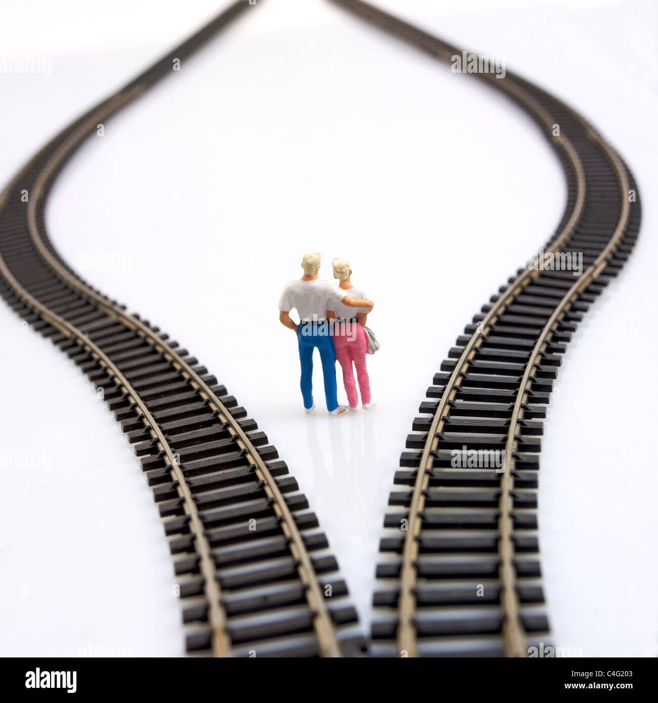 Couple choosing from different directions / choices / decisions / decision making concept - Stock Image
