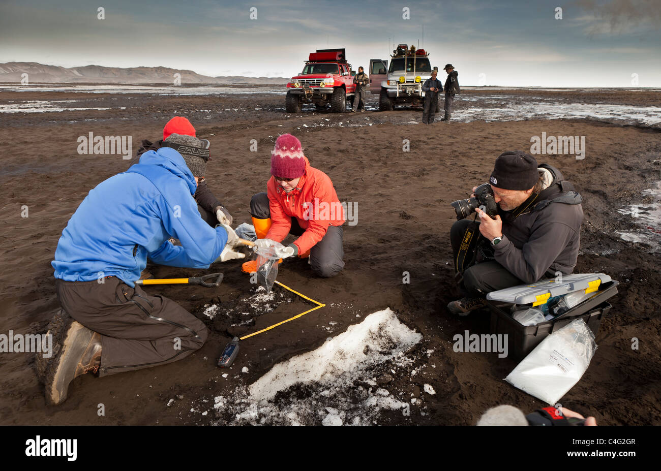 Scientist taking samples and measuring the ash fall from Grimsvotn volcanic eruption, Iceland - Stock Image