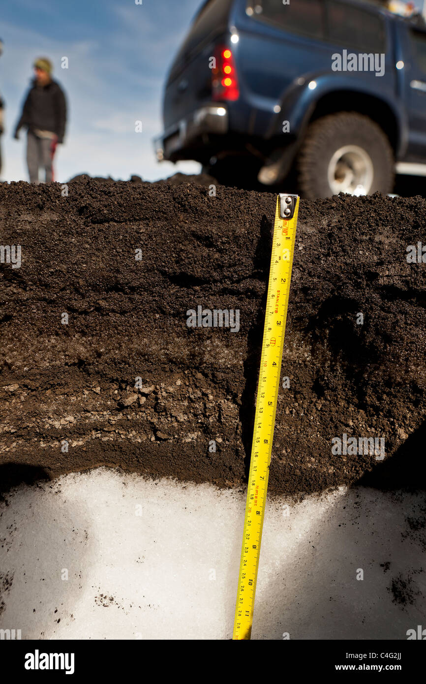Measuring layers of ash fall from Grimsvotn volcanic eruption, Iceland - Stock Image