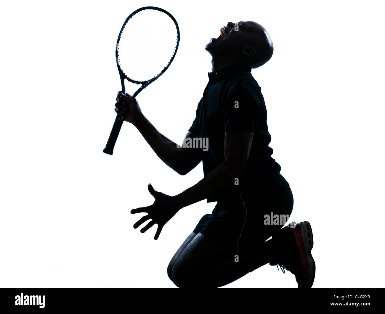 on man african afro american playing tennis player kneeling screaming on studio isolated on white background - Stock Image