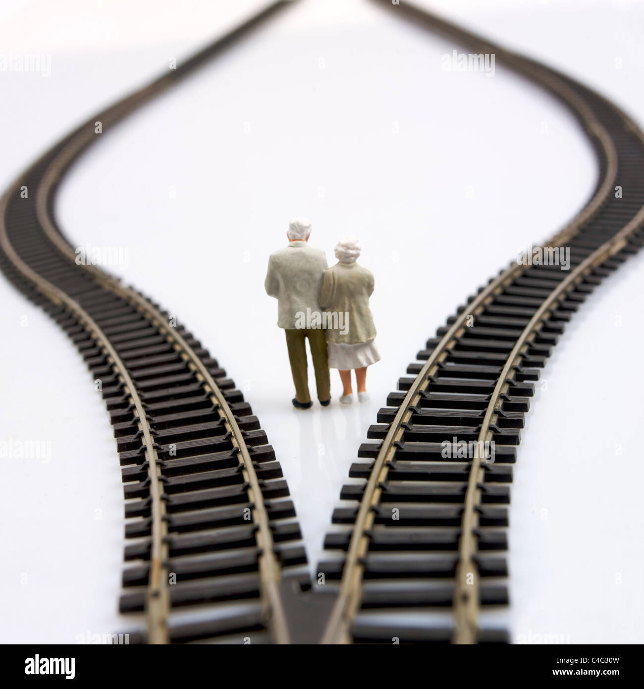 Old couple choosing which direction to take / life choices / choice, future decisions concept - Stock Image