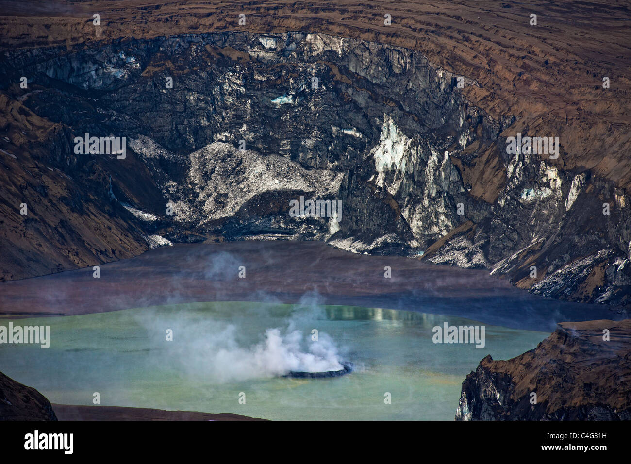 Grimsvotn crater steaming in lake, Grimsvotn volcanic eruption, Iceland - Stock Image