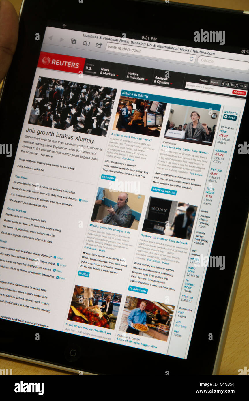 iPad with reuters online website showing global markets news - Stock Image