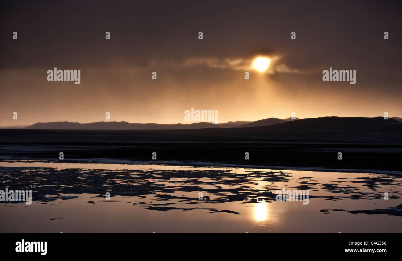 Sunset over glacial landscape, ash filled from the Grimsvotn volcanic eruption, Iceland - Stock Image
