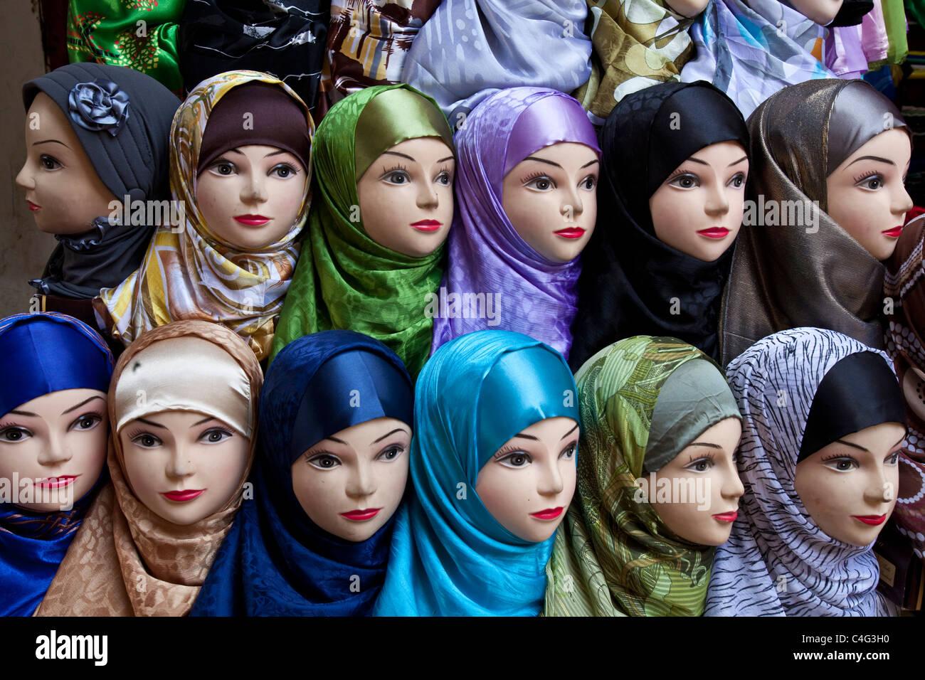 Womens headscarf display in a shop window, The Medina, Fez, Morocco Stock Photo