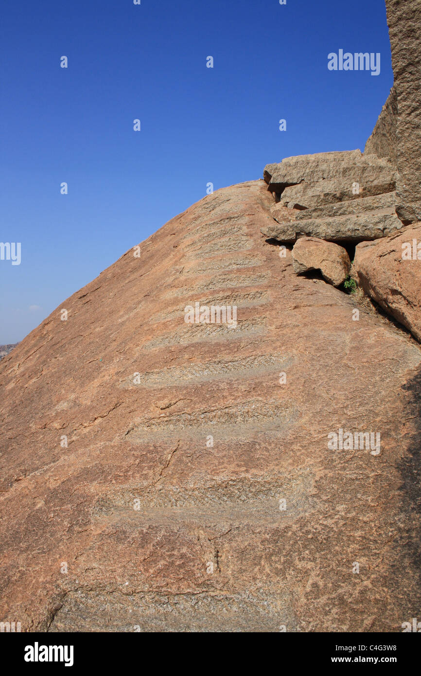 Stone Staircase leading upto a blue sky. - Stock Image