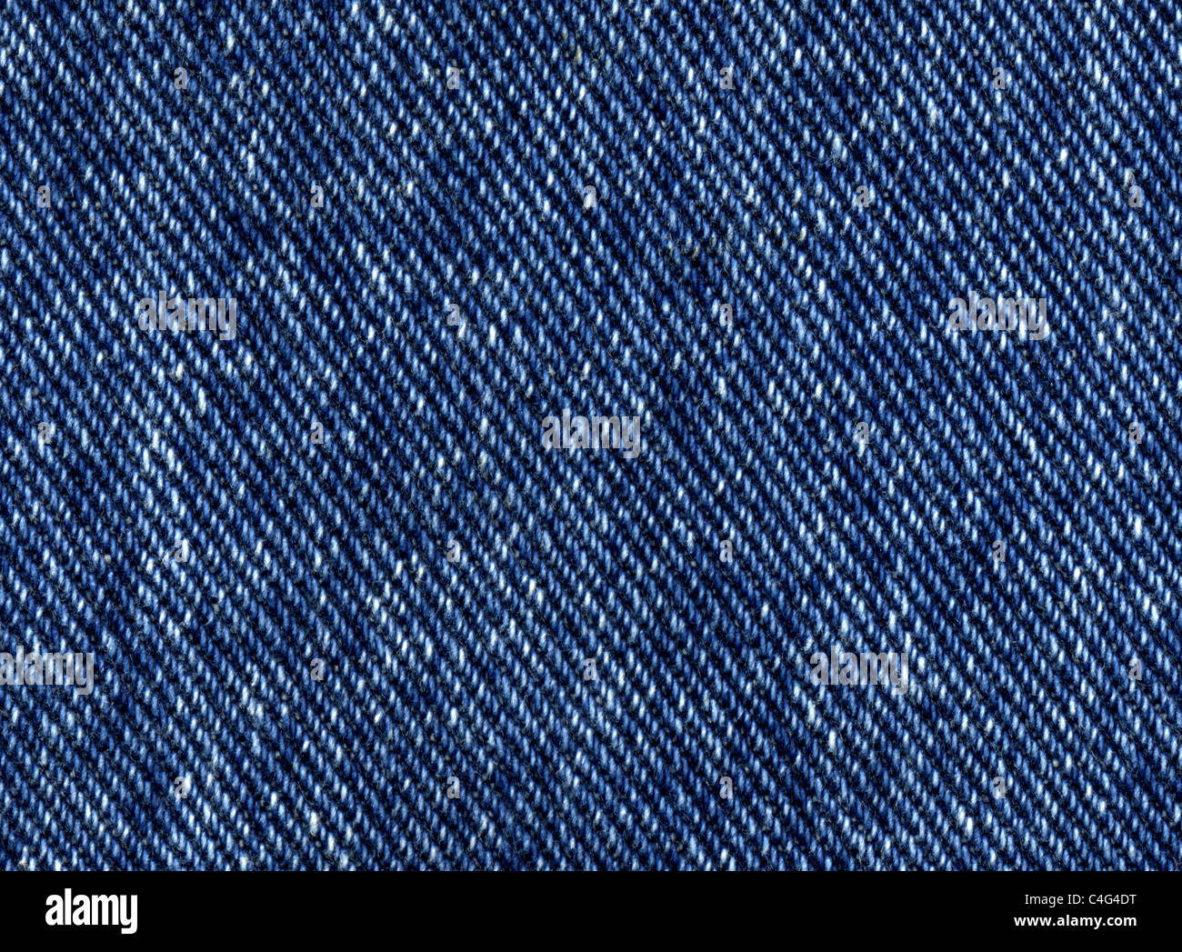 Dark blue denim jeans close up texture background - Stock Image
