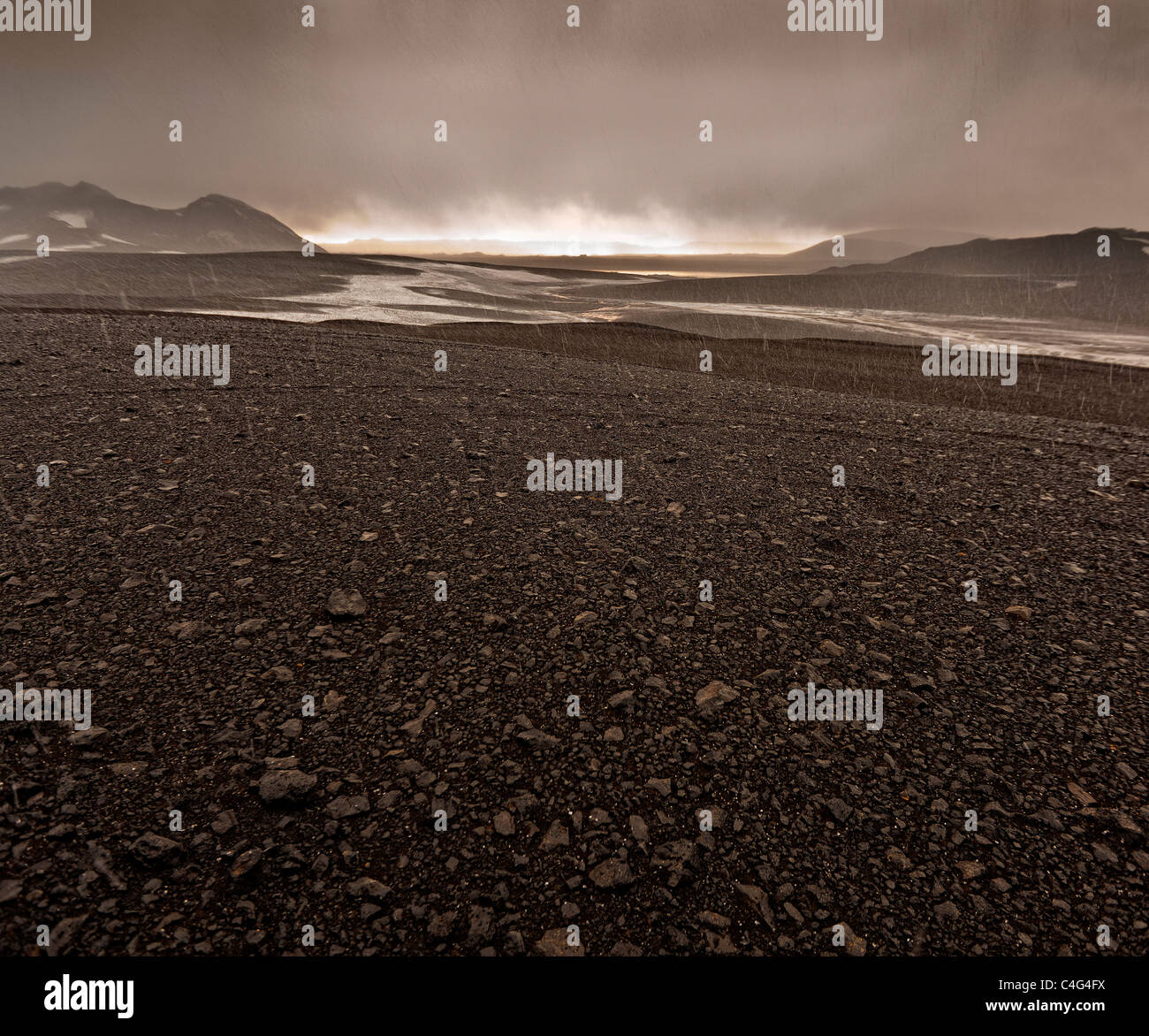 Bad weather with sleet and rain on ash filled glacial landscape, Grimsvotn volcanic eruption, Iceland - Stock Image