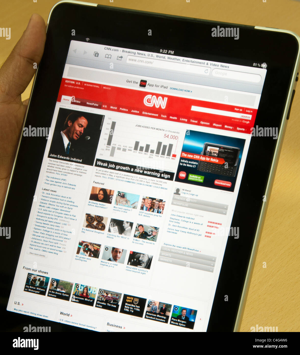 iPad with CNN online website showing global markets news - Stock Image