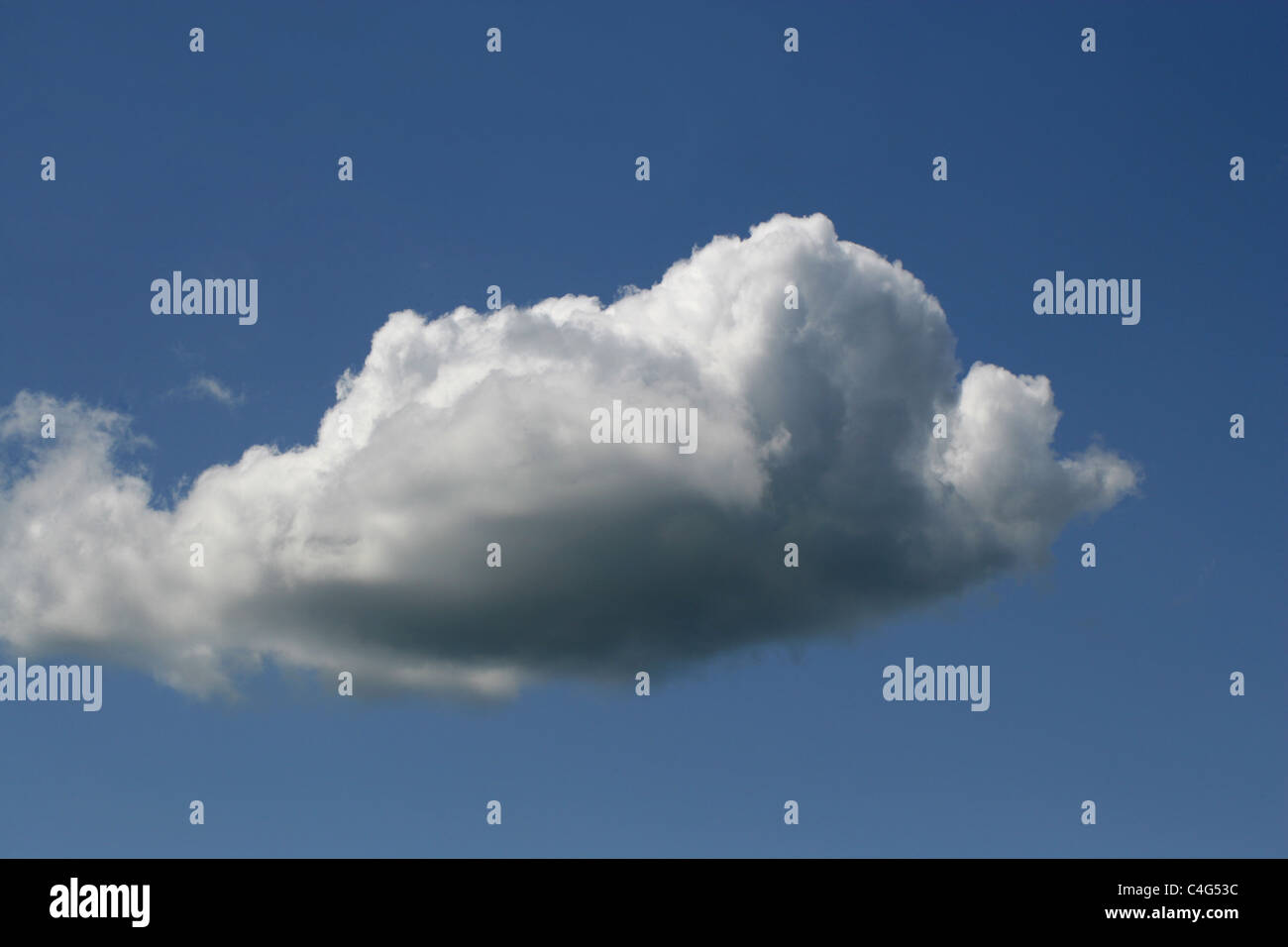 Cumulus Clouds in a Blue Sky. - Stock Image