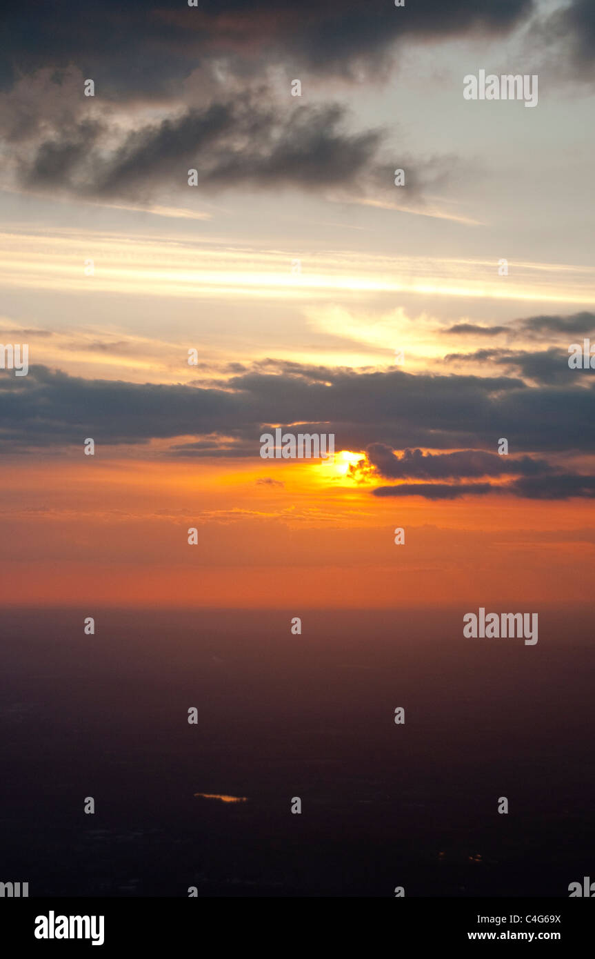 Orange sunset from the air - Stock Image
