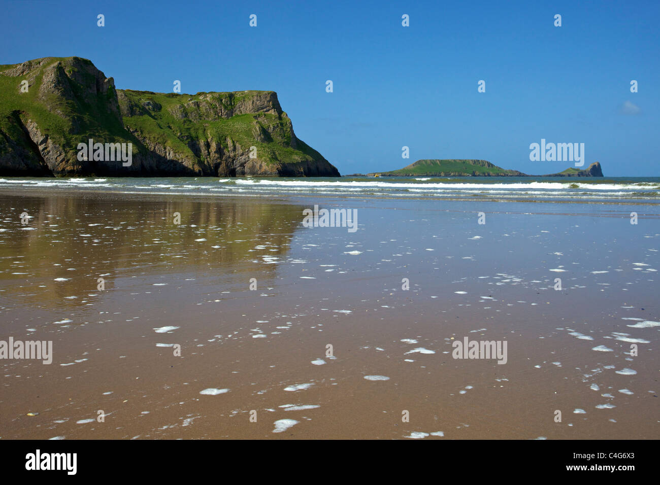 Rhossili Beach looking to Worm's Head in spring sunshine Gower Peninsula Wales Cymru UK GB British Isles - Stock Image