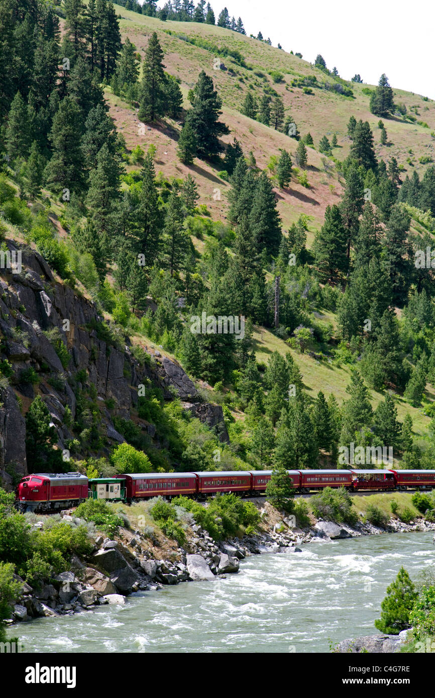 The Thunder Mountain Line scenic tourist train traveling along the Payette River between Horseshoe Bend and Banks, - Stock Image