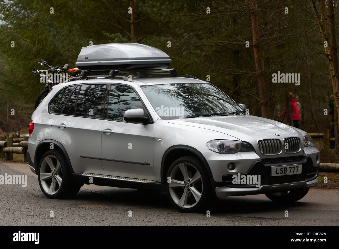 Silver BMW X5 with Car Roof Rack Luggage - Stock Image
