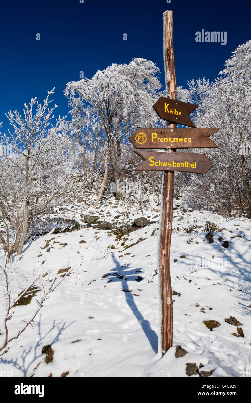 Sign posts for walkers in the Hoher Meissner National Park, in winter, North Hessen, Germany Stock Photo