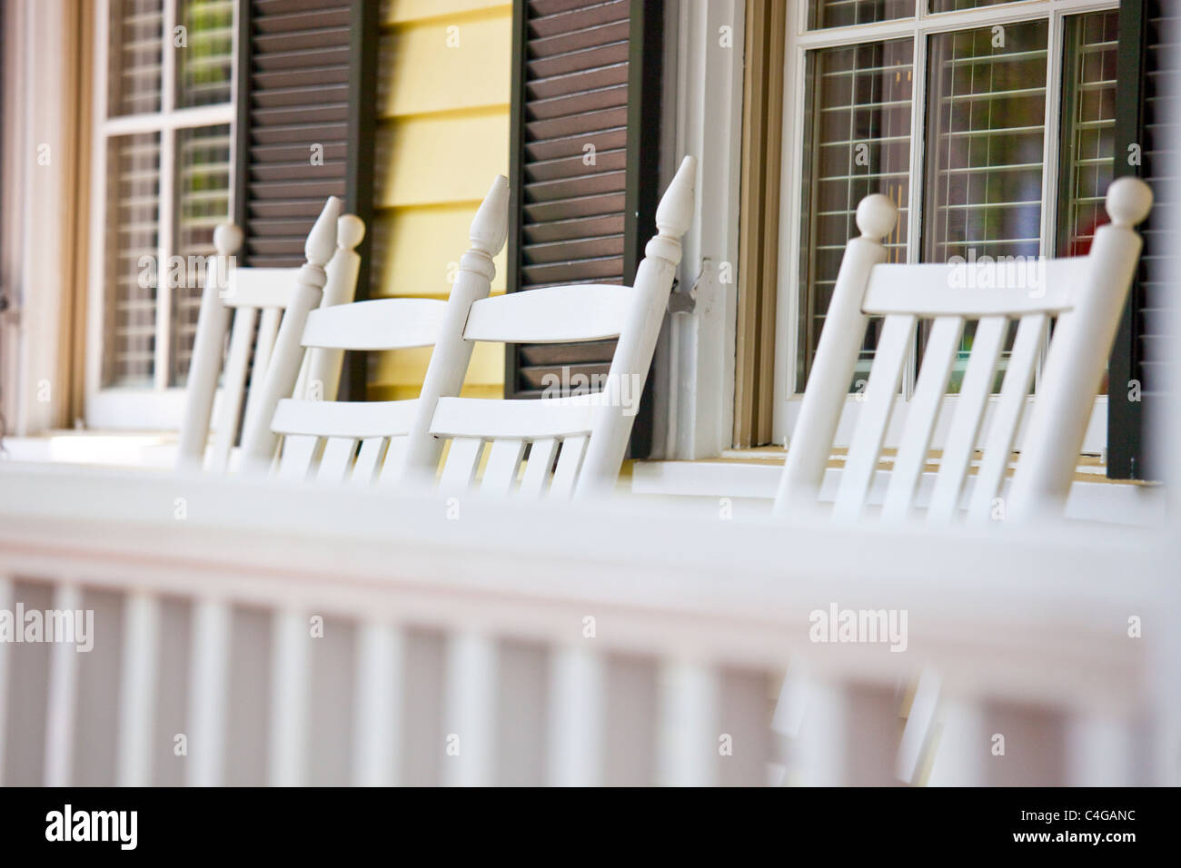 Rocking chairs on a front porch in Savannah, Georgia - Stock Image