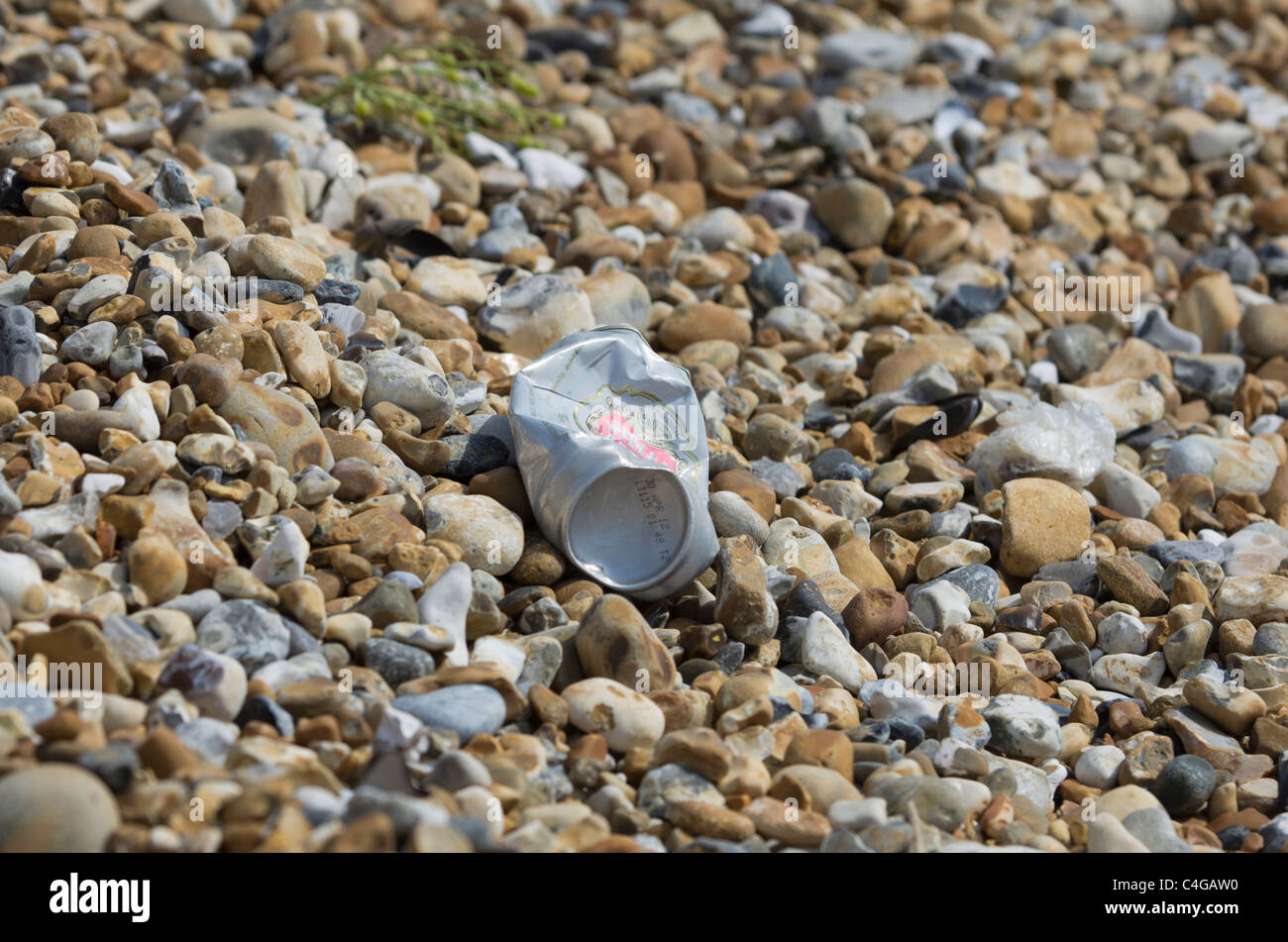 soft drink can washed up on pebble beach a Pevensey Bay East Sussex England - Stock Image